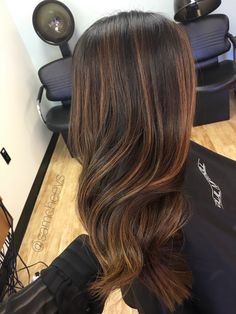 Soft blended honey golden sun kissed balayage highlights for dark brown and black hair types. Easy maintanence hair