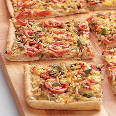 Carmelized Onion and White Bean Flatbread - Ingredients  • 3 tablespoon oil, olive, extra-virgin  • 1 large onion(s), thinly sliced lengthwise  • 1/4 teaspoon salt  • 20 ounce(s) pizza dough, whole wheat, thawed if frozen  • 2 tablespoon oregano, fresh, minced  • 1/2 teaspoon pepper, black ground  • 15 ounce(s) beans, white, rinsed  • 3 tablespoon water  • 2 teaspoon vinegar, white wine  • 2 tomato(es), plum,   • 1 cup(s) cheese, smoked Gouda, or cheddar finely shredded  •, pepitas, optional