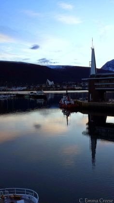 Tromso, North Norway. We fell in love with Norway from a height of 30,000 feet. Flying from Olso to Tromso, a small island city 200 miles into the Arctic circle, we couldn't believe our eyes as volcanic plateaus, fjords and deep green ocean unfolded from our small aeroplane window.