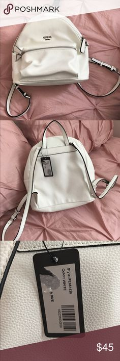 """AUTHENTIC NEVER USED GUESS MINI BACKPACK ✨ """"Pebbled faux-leather backpack features silver ton hardware, exterior pocket and triangle logo charm. Top zipper closure"""" - guessfactory.com  NEVER USED! Was given as a gift but as grateful as I am it's not really my style but hopefully somebody else will love it and enjoy it more than I could / no stains or damages :) Guess Bags Mini Bags"""