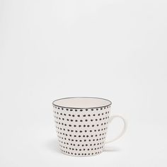 Image of the product Porcelain mug with irregular little dots