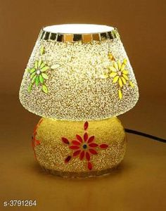 LED Lights & Lamps Multicolor Hand Decorative With Colorful Beads & Chips Glass Table Lamp  Product Type : Table Lamp  Material : Glass Cord Length:-60 inch Shade Length:-14 cm Description : It Has Set Of 1 Glass Table Lamp Country of Origin: India Sizes Available: Free Size *Proof of Safe Delivery! Click to know on Safety Standards of Delivery Partners- https://ltl.sh/y_nZrAV3  Catalog Rating: ★4.1 (1249)  Catalog Name: Multicolor Hand Decorative With Colorful Beads & Chips Glass Table Lamp Vol 2 CatalogID_531387 C103-SC1416 Code: 515-3791264-