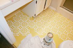 You can paint linoleum? Get out!  Maybe a cheap fix for the teeny tiny bathrooms...