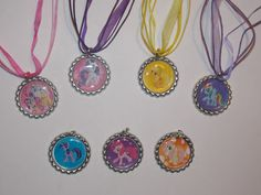 This listing includes 7 My Little Pony bottle cap necklaces, one of each character pictured. Images are attached to flattened silver bottle