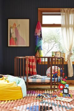 Colorful nursery, but really love the deep navy wall color to bring a relaxed mood to the room.