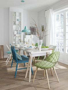 White dining space with splashes of blue and green. #interior #design