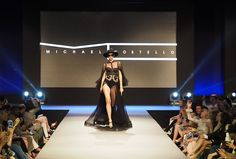 Va va voom! Michael Costello's transparent black lacy cape gown. Halloween gone glam? We're into it. Fashion Week El Paseo 2017