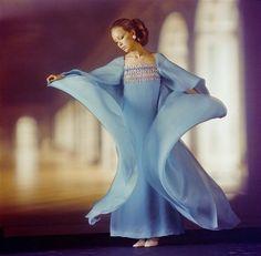 Model wearing an evening dress by Pierre Balmain, 1970. Photo by Sam Lévin.