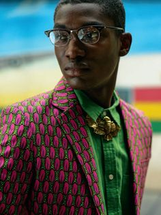Suit jacket with a pop out print! #africanprint #ankara #mixedprints #tailored #menswear #suit #Africanprints #Ethnicprints #Africanmen #pinkandgreen #AfricanStyle #Ankara
