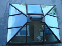 Satin Black with Contemporary Style Ball Finials Skylights