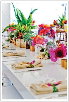 Bold tropical inspired flowers created a splash of color for this beachy chic San Diego wedding. Design by Alchemy Fine Events, Flowers by Isari Flower Studio