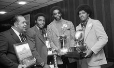 Tennessee State coach John Merritt, left, and three senior members of his football team display just a sampling of the trophies and plaques that were presented at a Testimonial Dinner honoring the Tigers at the Airport Hilton Jan. 21, 1974. Honorees with Coach Merritt are linebacker Waymond Bryant, defensive end Ed