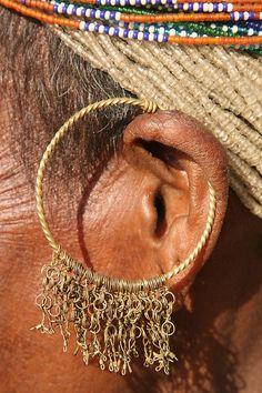 *Traditional ear piercing of the Bonda women, Odisha (Orissa), India.