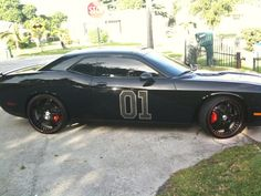 "Originally Chad Ochocinco was driving around with a orange Dodge Challenger but now, Ochocinco's switched things up and changed his Challenger to his own version of The General Lee with this Dodge Challenger named the ""General O. Dodge Srt, Chad Ochocinco, Celebrity Cars, Bentley Mulsanne, General Lee, Best Classic Cars, Chrysler Jeep, Pony Car, Autos"