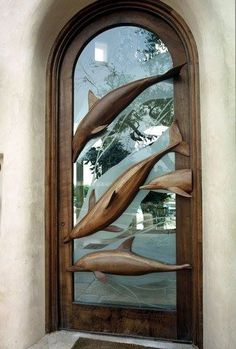 Beautiful door glass and wood with dolphins