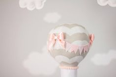 """Hippo hot air balloon baby mobile nursery decor, travel theme mobile with a baby hippo floating along in a little 3D printed boat/basket. Pink and Gray nursery décor for a travel theme nursery. She is wearing pink overalls with a little puffy handmade bow on her head. Matching bows adorn the hot air balloon. Tiny little eyelashes were added for the perfect girly touch. Shes holding a little shabby heart. You can personalize one of the clouds with baby's name or a short saying """"Dream Big""""…"""