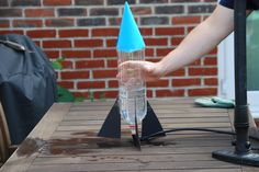 Bottle Rocket..What you need....empty plastic bottle, cardboard made into a cone and 4 fins, a cork, a pump with a needle adaptor, water....This has a video, this thing takes off!
