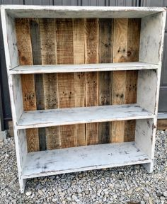 White distressed bookshelf with pallet backing!