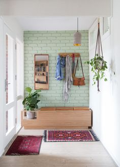 Functional Mudroom Designs: Bohemian Scandi hallway with pastel green brick wall, wood accents and eclectic rugs Brick Interior, Interior Walls, Home Interior, Painted Brick Walls, Brick Accent Walls, Brick Wall Decor, Wall Wood, Eclectic Rugs, Eclectic Design