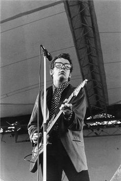 Elvis Costello playing at the Rock Against Racism Concert in a park in North London 1979