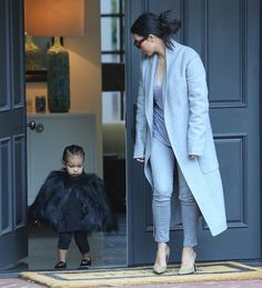 THUG LIFE./ SHE LOOKS LIKE A BAT!  THAT JACKET, AND I DON'T CARE WHICH DESIGNER MADE IT, IS THE UGLIEST THING I'VE EVER SEEN!  WHY DOES KIM INSIST ON WEARING ALL THIS UGLY, DARK CRAP ON SUCH A PRECIOUS LITTLE GIRL? WHY?
