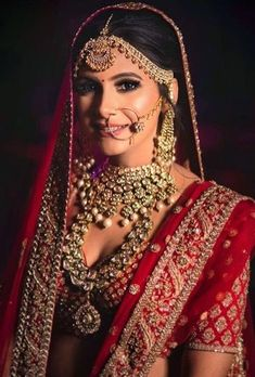 beautiful indian bride in a red wedding Lehenga and traditional polki bridal necklace jewellery. Best Bridal Makeup, Indian Bridal Makeup, Indian Bridal Outfits, Indian Bridal Fashion, Asian Bridal, Indian Wedding Jewelry, Wedding Makeup, Indian Bridal Wear, Bride Makeup