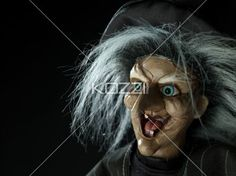 image of a witch over dark background. - Close-up image of a witch over dark background.
