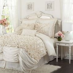 "Faux silk comforter set with cascading ruffle detail.          Product: Queen: Comforter, bedskirt and 2 2 king   Dimensions: Standard Sham: 20"" x 26"" eachKing Sham: 20"" x 36"" eachQueen Comforter: 92"" x 96""King Comforter: 96"" x 110""California King Comforter: 96"" x 110"" Note: Accent pillows not included. Shams do not include inserts.    Cleaning and Care: Dry clean"