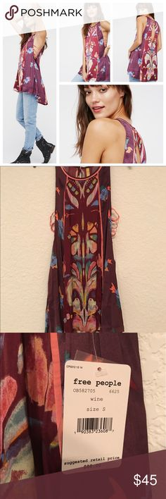 Free People Dream Free Printed Tunic Brand-new, with tags attached. No flaws that I can see. Material is soft and silky feeling. Really cute and I think you would need to wear a tank top underneath since the arms come down pretty low. The color is wine, so I put purple and red. Feel free to ask if you have any questions, no trades or PayPal, and lowball offers will be blocked. Thank you so much for looking! 🌺 Free People Tops Tunics