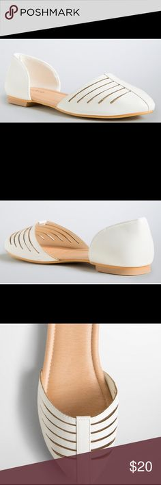 Torrid Ivory Strappy D'Orsay Flats size 10W Up for grabs is this pair of shoes from Torrid. They are a size 10W with flat soles. These flats are D'Orsay style (sideless) with straps over the rounded pointed toe. They are ivory colored faux leather. These flats are new with the original tag. *They are sold in stores without a box, so no box is included.* torrid Shoes Flats & Loafers