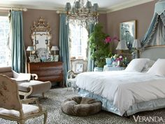 """This place is a creative outlet for her, a gift,"" he says. ""She lives in that house and opens it up to friends, family, and guests — and that's how it was meant to be used."" The master bedroom is a celebration of old-fashioned opulence. Bedding, Matouk. Curtains made by David Haag. Satin curtain and ruffled, striped silk undercurtain, Brunschwig & Fils. Chinoiserie mirror, Travis and Co. Chandelier, Georgia Lighting. Carpet, Oscar de la Renta Home for Elson & Co.   - Veranda.com"