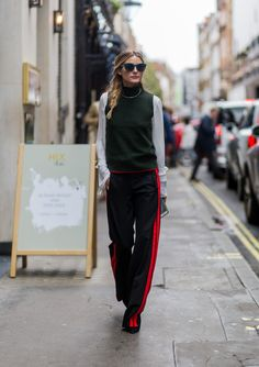 Olivia Palermo masters a casual combo in sporty trousers. Don't forget your sunglasses.