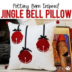 Create a dramatically beautiful jingle bell Christmas pillow out of felt and imagination for far less than any sticker price.