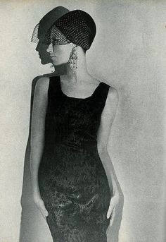 Bettina Lauer in a small, sleek broadtail lamb dress by Revillon, hat by Halston, photo by Helmut Newton for Vogue 1965