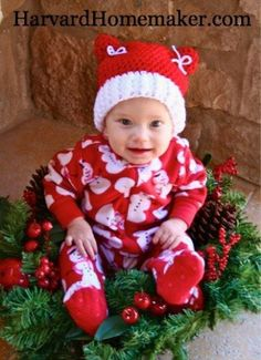 Tuck your baby in a wreath to keep him/her from crawling away from you while you are trying to snap a picture!  Cute idea for the little ones celebrating a first Christmas!  #Baby'sFirstChristmas