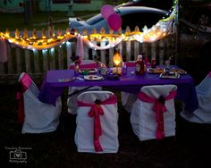 Cute set up with the lights lit up around the table and the chairs make them feel like princesses