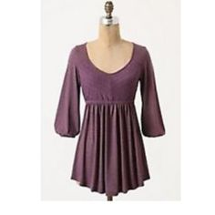"""Anthro Emaline Pullover By Puella Purple Sz S EUC! Puella - Anthropologie  Size S  """"Emaline"""" Pullover in Purple  """"An eyelet bodice tops the skirted bottom of Puella's babydoll top that hugs & gives in all the right places. Pair w/ leggings for all-around comfort.""""  Excellent used condition!  Poly & Rayon  Bust: 15.5"""" across the front, lying flat. Has stretch!  Length: 25"""" from shoulder to hem  ✳️Bundle to Save 20%! ❌No Trades, Holds, PP 100% Authentic   Suggested User / 900+ Sales / Fast…"""