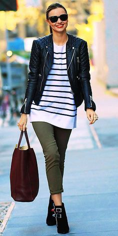 cropped moto jacket over a striped tunic and cropped pants, and finishing the look with comfy-yet-cool buckled boots.