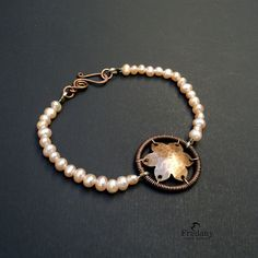 Copper bracelet and pearls.
