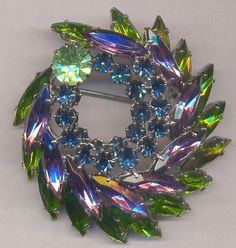 FOUR TREASURY Lists....Vintage Brooch...Unsigned SHERMAN....Amethyst... Peridot...Sapphire Rhinestone Tiered Brooch on Etsy, $48.35