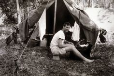 NTM Founder Paul Fleming in Malaysia with tent and typewriter.