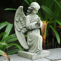 """16"""" Kneeling and Praying Angel Outdoor Patio Garden Statue by CC Outdoor Living. $59.99. Kneeling and Praying Angel Garden StatueItem #18507Features natural mossy-green and grayish tones with a textured lookFor indoor/outdoor useDimensions: 16""""H x 7.25""""W x 8""""DMaterial(s): resin/stone mix. Save 40%!"""