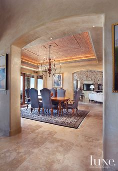 A ceiling clad in reclaimed bricks, fabricated by Jim Wood Masonry, is the highlight of this dining room.