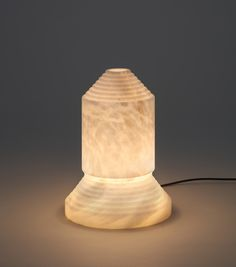 BABEL is a solid alabaster column. A totem of light that e stands as a clear illustration of an evening tête-à-tête. #light #lamp