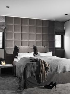 Love the upholstered bed. Dark hotel style design