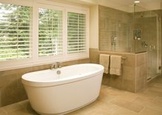 Nice tile, tub and shutters.