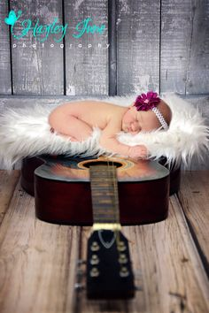 Doesn't she look previous sleeping on her Daddy's guitar?  Newborn, newborn girl pictures, guitar picture, Hayley June Photography, Calgary Newborn Photo, baby girl,