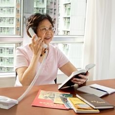 One of Jehovah's Witnesses preaching by telephone in Hong Kong