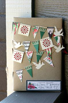 Made from giftpaper/fabric scraps.  Sewn together with sewing machine.  Can be made ahead and stored on an empty cotton reel.