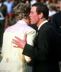 That kiss: Princess Diana turns away as Prince Charles leans in to kiss her on the cheek at a prize-giving ceremony following a polo match in Jaipur, India in 1992